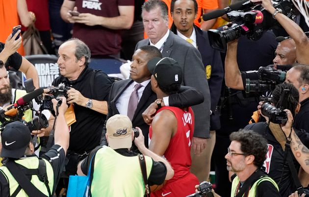 Toronto Raptors general manager Masai Ujiri, centre left, walking with guard Kyle Lowry after the Raptors...