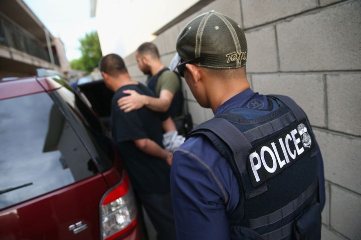 A man is detained by Immigration and Customs Enforcement agents on Oct. 14, 2015, in Los Angeles.