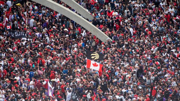 Fans pack Nathan Phillips Square at City Hall ahead of the 2019 Toronto Raptors NBA basketball championship parade in Toronto, Monday, June 17, 2019. (Andrew Lahodynskyj/The Canadian Press via AP)