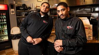 SUMMIT, NJ - MARCH 30: Edwin, left and Edward Roman pose for photos in the restaurant Village Trattoria in Summit, NJ on April 11, 2019. Edwing and Edward both have genetic heart conditions that will require them to have heart transplants within their lifetime. (Photo by Damon Dahlen/HuffPost) *** Local Caption ***