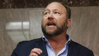 Alex Jones of Infowars talks to the media while visiting the U.S. Senate's Dirksen Senate office building as Twitter CEO Jack Dorsey testifies before a Senate Intelligence Committee hearing on Capitol Hill in Washington, U.S., September 5, 2018. Twitter permanently banned Jones and Infowars from its platforms September 6 over his actions seen on Twitter while visiting the building. Picture taken September 5, 2018. REUTERS/Jim Bourg