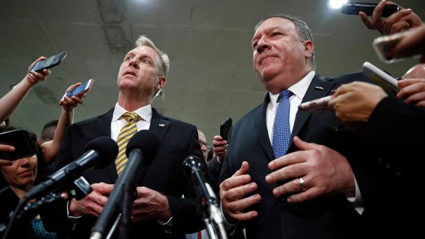 In this May 21, 2019, photo, acting Defense Secretary Patrick Shanahan, left, and Secretary of State Mike Pompeo speak to members of the media after a classified briefing for members of Congress on Iran on Capitol Hill in Washington. U.S. officials say the Pentagon will present plans to the White House to send up to 10,000 more American troops to the Middle East to beef up defenses against potential Iranian threats. The officials said no decision has been made and it's not clear if the White House will approve sending all or just some of the requested forces. (AP Photo/Patrick Semansky)