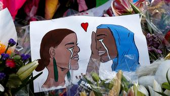 Flowers and cards are seen at the memorial site for the victims of Friday's shooting, outside Al Noor mosque in Christchurch, New Zealand March 19, 2019. REUTERS/Edgar Su