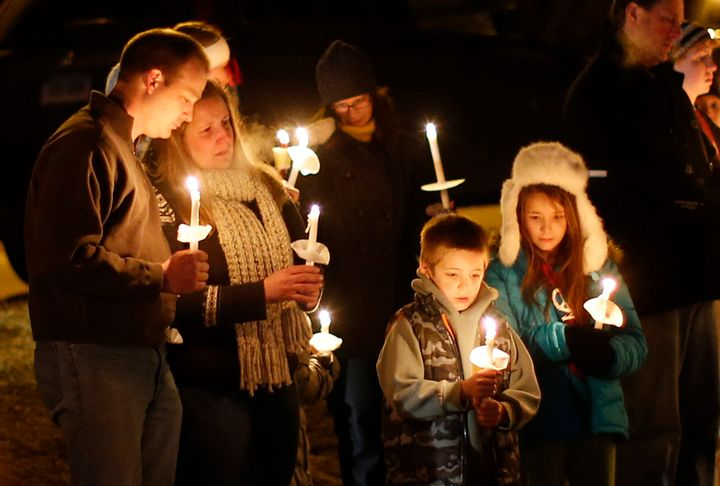 Mourners gather for a candlelight vigil at Ram's Pasture to remember shooting victims, Saturday, Dec. 15, 2012 in Newtown, Co