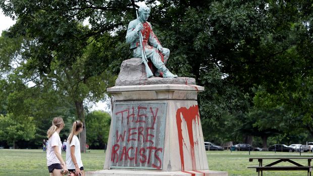 "People walk past a monument to Confederate soldiers in Centennial Park Monday, June 17, 2019, in Nashville, Tenn. Police discovered Monday the monument was vandalized with red paint and the phrase ""They were racists"" was painted over the names of Civil War soldiers. (AP Photo/Mark Humphrey)"