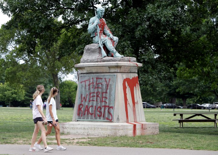 People walk past a monument to Confederate soldiers in Centennial Park in Nashville, Tennessee, on Monday.