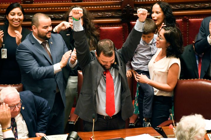 State Sen. Luis R. Sepulveda (D-Bronx), center, celebrates after the Green Light Bill granting undocumented immigrant driver'