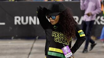 Cedella Marley poses with Jamaica's Women football team 'Reggae Girlz'  after the friendly football match Jamaica vs Panama at the National Stadium in Kingston, Jamaica, on May 19, 2019. - In Jamaica, the spirit of Bob Marley is inescapable: it permeates the Caribbean island nation, even its football pitches -- a sign of the late reggae legend's passion for the sport. After Marley's death, his children picked up the torch -- and the country's women's team, who have qualified for their first-ever World Cup this summer in France, owe a lot to the musician's daughter Cedella. (Photo by Angela Weiss / AFP)        (Photo credit should read ANGELA WEISS/AFP/Getty Images)