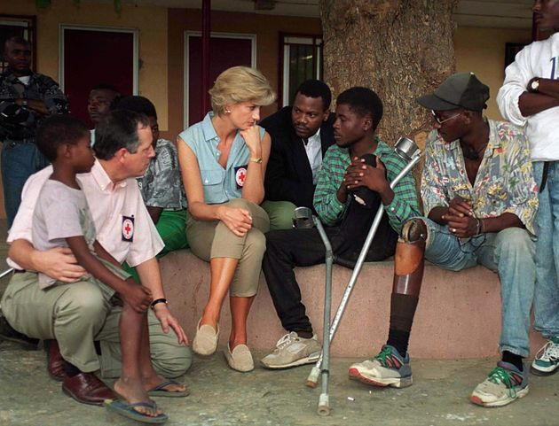 Princess Diana sits with victims of land mines at Neves Bendinha, an orthopedic workshop In Luanda, Angola...