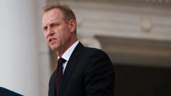 ARLINGTON, VA - MAY 27: U.S. Acting Secretary of Defense Patrick Shanahan delivers remarks during a Memorial Day ceremony at Arlington National Cemetery on May 27, 2019 in Arlington, Virginia. (Photo by Tom Brenner/Getty Images)