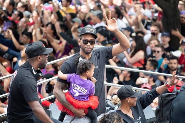 Kawhi Leonard and his daughter in Toronto On June 17,