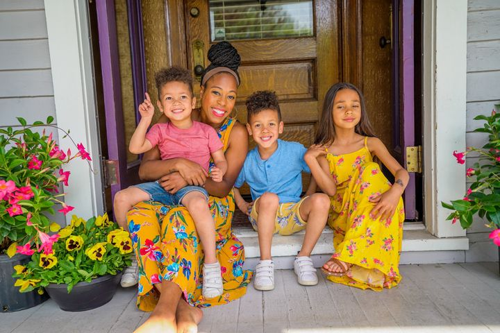 Britt Null, pictured here with her three children, runs a family-friendly vlog on YouTube.