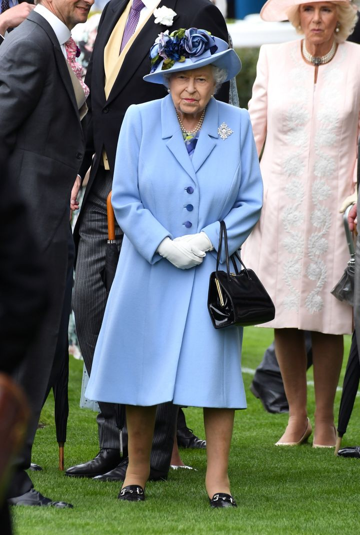 Queen Elizabeth II, with Camilla, Duchess of Cornwall, right behind her.