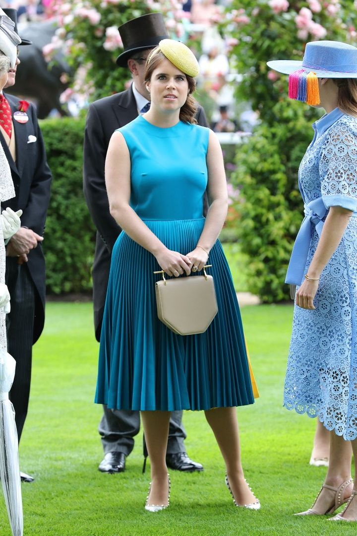 Princess Eugenie paired her teal blue dress with a bright yellow hat and a neutral clutch.