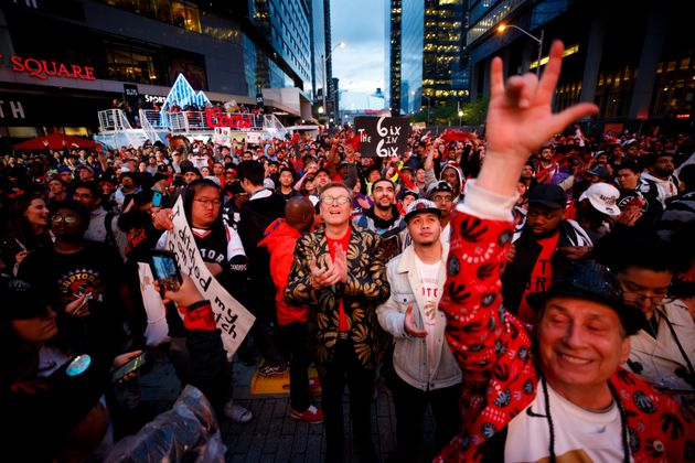 Toronto Mayor John Tory (gold jacket) cheers with Raptors fans outside of Scotiabank Arena on June 13,...