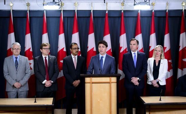 Prime Minister Justin Trudeau announces the government's decision on the Trans Mountain Expansion Project with Environment Minister Catherine McKenna, Finance Minister Bill Morneau, Natural Resources Minister Amarjeet Sohi, Fisheries Minister Jonathan Wilkinson and Transport Minister Marc Garneau in Ottawa on June 18, 2019.