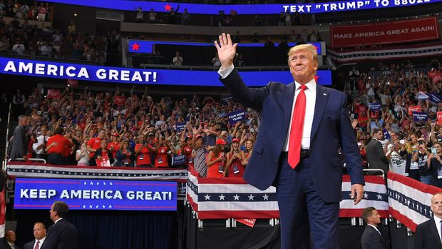 US President Donald Trump arrives to speak during a rally at the Amway Center in Orlando, Florida to officially launch his 2020 campaign on June 18, 2019. - Trump kicks off his reelection campaign at what promised to be a rollicking evening rally in Orlando. (Photo by MANDEL NGAN / AFP)        (Photo credit should read MANDEL NGAN/AFP/Getty Images)