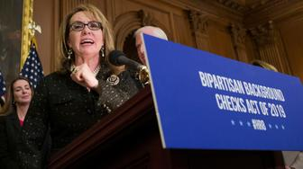 Former Rep. Gabby Giffords, speaks during a news conference to announce the introduction of bipartisan legislation to expand background checks for sales and transfers of firearms, on Capitol Hill, Tuesday, Jan. 8, 2019 in Washington. (AP Photo/Alex Brandon)