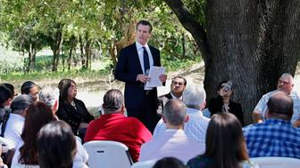 Gov. Gavin Newsom addresses a meeting with Native American tribal leaders from around the state at the future site of the California Indian Heritage Center in West Sacramento, Calif., Tuesday, June 18, 2019. Newsom took the occasion to formally apologize to tribal leaders from around California for the violence, mistreatment and neglect inflicted on Native Americans throughout the state's history. (AP Photo/Rich Pedroncelli)