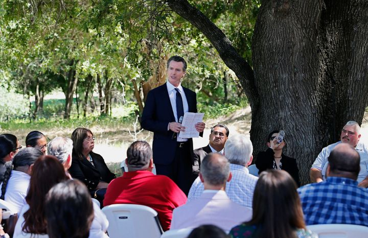 Gov. Gavin Newsom addresses a meeting with Native American tribal leaders from around the state at the future site of the Cal
