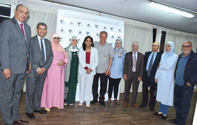 Amina Bouayachprésidente du CNDH, entourée de membres du Conseil national des droits...