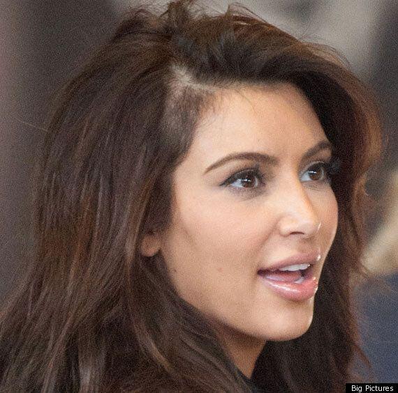 Kim Kardashian Displays Bald Patch At Paris Fashion
