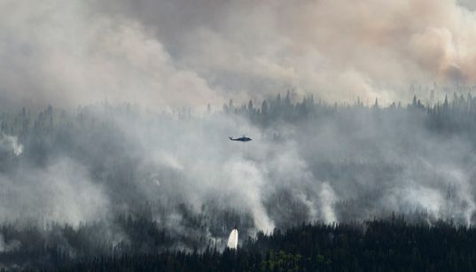 Raging Wildfire Forces 9,000 To Flee Their Homes In Northern