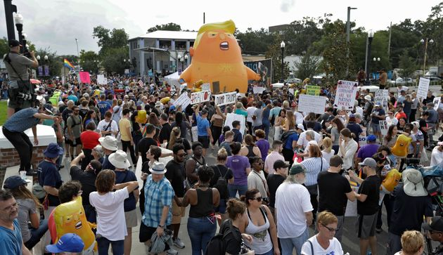 An inflatable Baby Trump balloon towered over protesters during a rally Tuesday, June 18, in Orlando,...