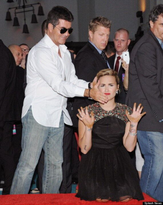 Simon Cowell, Britney Spears, Demi Lovato, LA Reid Appear At Handprint Ceremony Ahead Of The Official...