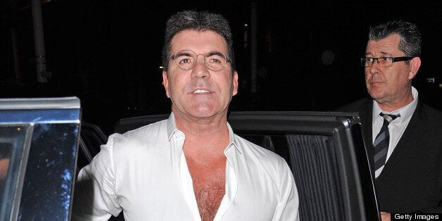 LONDON, UNITED KINGDOM - APRIL 11: Simon Cowell sighting arriving at the My Beautiful Ball fundraiser...