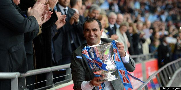 LONDON, ENGLAND - MAY 11: Wigan Athletic manager Roberto Martinez celebrates with the trophy after victory...