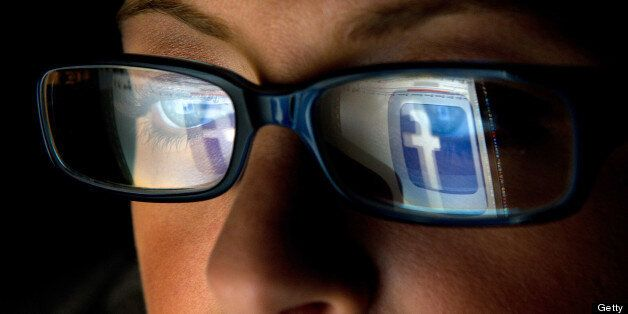 FILE: In this file photo the Facebook Inc. logo is reflected in the eyeglasses of a user in this arranged...
