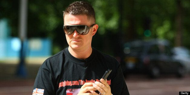 LONDON, ENGLAND - JUNE 29: Joint EDL leader Tommy Robinson walks along the Mall on June 29, 2013 in London,...