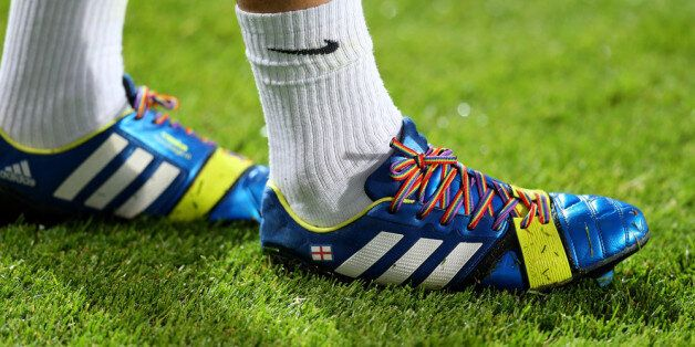 LONDON, ENGLAND - SEPTEMBER 18: Joey Barton of QPR wears rainbow-coloured shoe laces as part of a campaign...