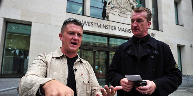 (FILES) In this file picture taken on September 11, 2013 Stephen Yaxley-Lennon (L), also known as Tommy...