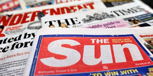 Detailed view of a pile of National newspapers including The Times, The Independent, The Sun and the...