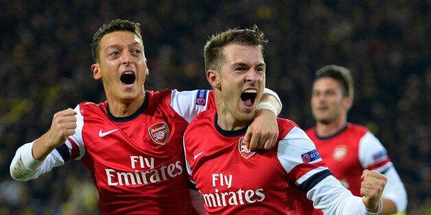 Arsenal's Welsh midfielder Aaron Ramsey celebrates scoring the opening goal with Arsenal's German midfielder...