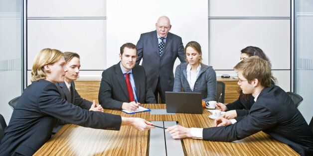 seven people in a cubicle