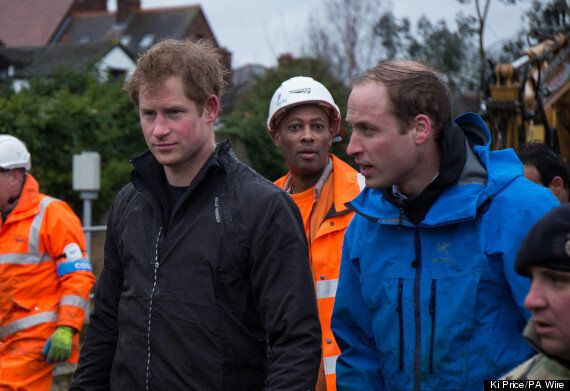 Prince William And Harry Help Shift Sandbags, Challenge Reporter To Help Out