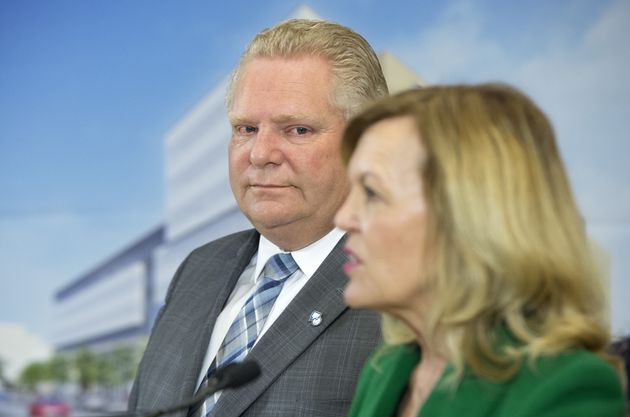 Ontario Premier Doug Ford watches as Health Minister Christine Elliott speaks at an event at The Centre...