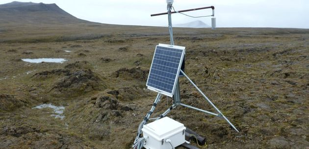 Solar-powered scientific equipment records data in a landscape of partially thawed Arctic permafrost...