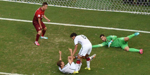 Germany's forward Thomas Mueller (C) celebrates with teammate Germany's midfielder Sami Khedira (2R)...