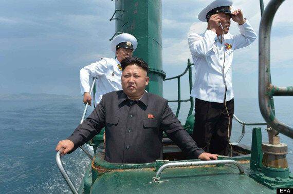 North Korea's Hero: Kim Jong Un Poses Nobly Atop Ageing Submarine