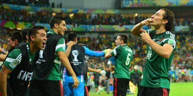 Mexico's defender Andres Guardado (R) celebrates with Mexico's midfielder Jose Juan Vazquez after scoring...