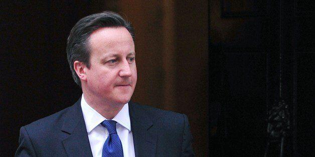 British Prime Minister David Cameron (L) prepares to welcome Irish President Michael Higgins at Downing...