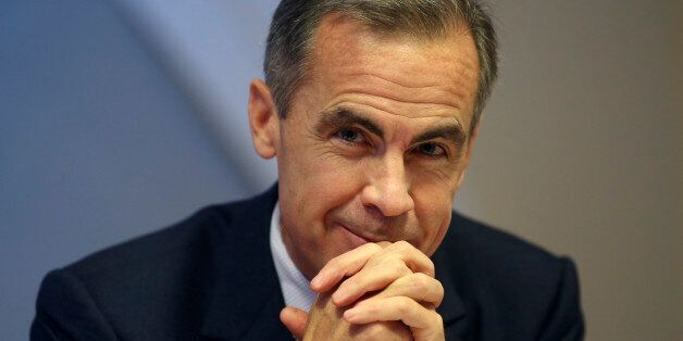 Mark Carney, governor of the Bank of England, smiles during a news conference following the results of...