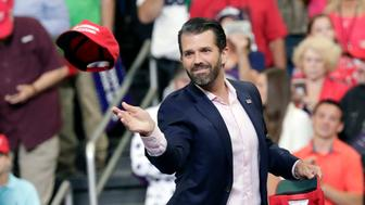 Donald Trump Jr. throws hats to supporters at a rally for President Donald Trump in his 2020 re-election bid Tuesday, June 18, 2019, in Orlando, Fla. (AP Photo/John Raoux)