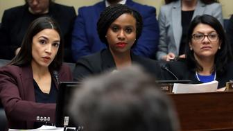 WASHINGTON, DC - FEBRUARY 27: (EDITORS NOTE: Retransmission with alternate crop.)  (L-R) Rep. Alexandria Ocasio-Cortez (D-NY), Rep. Ayanna Pressley (D-MA) and Rep. Rashida Tlaib (D-MI) listen as Michael Cohen, former attorney and fixer for President Donald Trump, testifies before the House Oversight Committee on Capitol Hill February 27, 2019 in Washington, DC. Last year Cohen was sentenced to three years in prison and ordered to pay a $50,000 fine for tax evasion, making false statements to a financial institution, unlawful excessive campaign contributions and lying to Congress as part of special counsel Robert Mueller's investigation into Russian meddling in the 2016 presidential elections. (Photo by Chip Somodevilla/Getty Images)