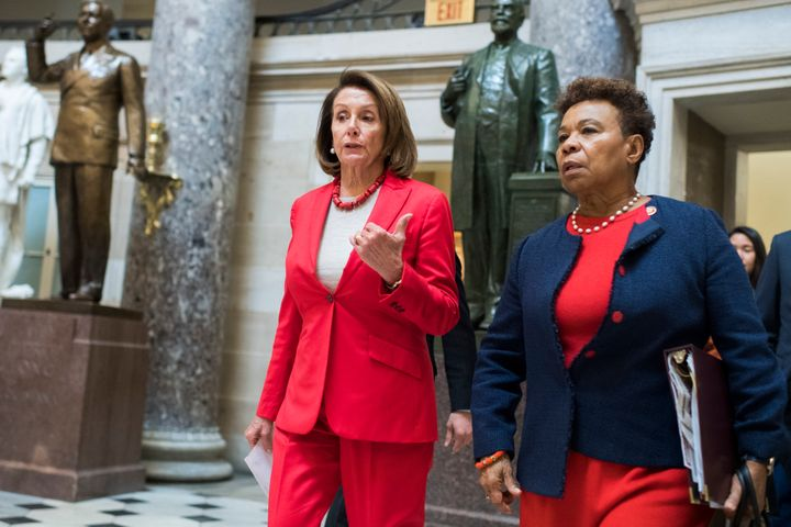 Speaker Nancy Pelosi (left) and Rep. Barbara Lee walk through the Capitol. Lee has led the fight to repeal the 2001 Authoriza