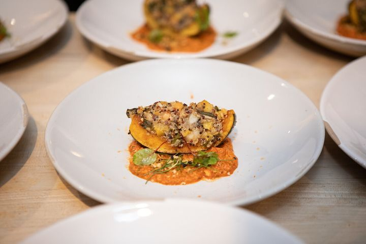Roasted squash with collard greens, kuchela, creamed peas and preserved peach; romesco, and citrus-toasted bread crumbs.